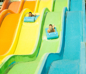 Two boys having fun in  waterslide