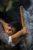 Man Praying With Incense at Lama Temple, Beijing, China