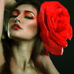 portrait of fashion glamour girl with red flower in her hair