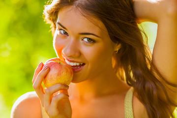 closeup girl portrait holding apple