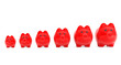 Growing investment concept. Red Piggy Banks in row