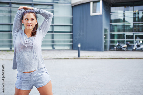 Sporty woman warming up before running