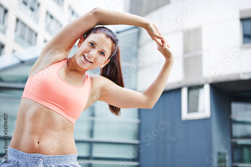Athletic woman exercising in the city