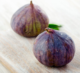 fresh figs on  wooden table.