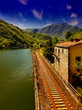 Railway with River, Sky and Vegetation in Tuscany