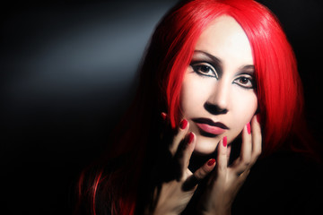 Woman in red hair wig portrait