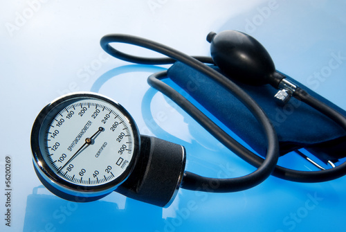 Sphygmomanometer on blue, reflective background
