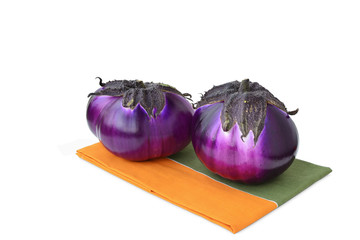 Two round eggplants