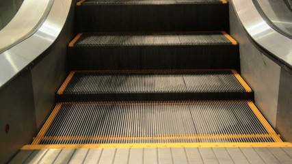 movement of the  escalators stairway inside  shopping center