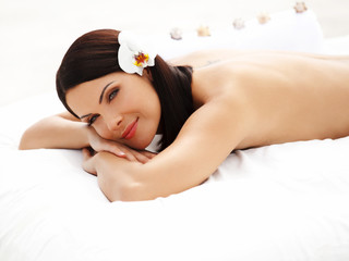 Spa Woman. Beautiful young woman relaxing after massage.