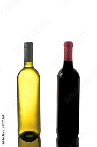red and white wine bottles with reflection