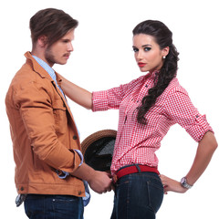 casual couple with man taking her belt off
