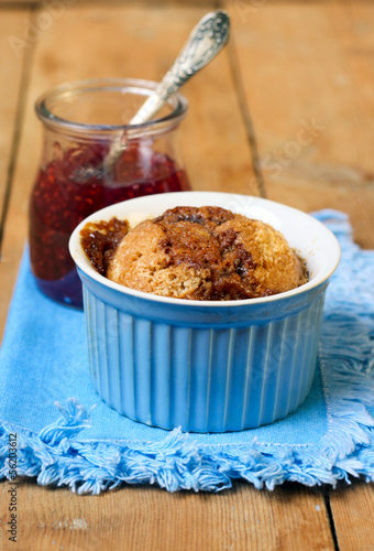 Cake in blue ramekin and jam in jar