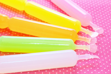 Colorful ice candies on a background of polka dots