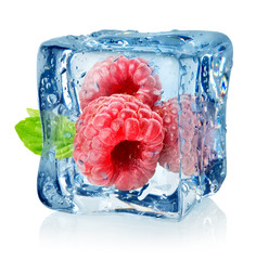 Ice cube and raspberries isolated