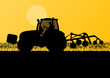 Agriculture tractor cultivating the land in cultivated country g