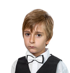 Portrait of a boy in a jacket with a bow tie.