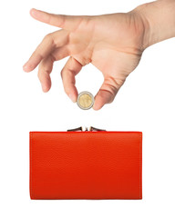 red purse (wallet) and hand with coin isolated on white