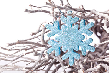 christmas snowflake star decoration on a branch