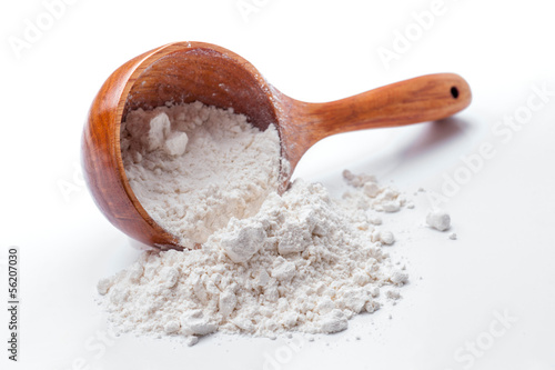 classic wooden dipper with flour
