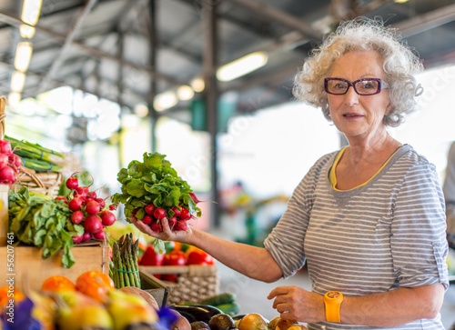 portrait of a happy senior woman at the market