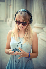 beautiful blonde woman listening to music