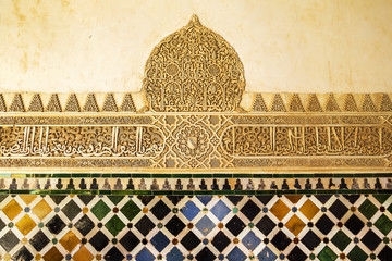 Wall detail of ceramic tile at the Alhambra, Granada, Spain.