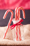 red and white candy cane in a jar