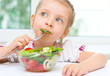 child eating vegetable salad