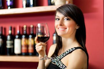 Woman toasting wine
