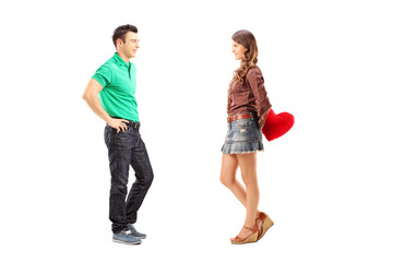 Male and female with red heart during a conversation