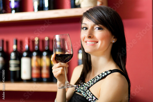 Woman toasting wine