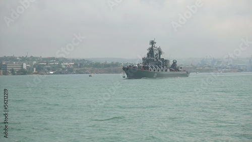 military ship goes to sea from the bay
