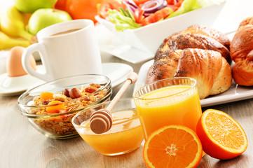 Breakfast including coffee, bread, honey, orange juice, muesli a