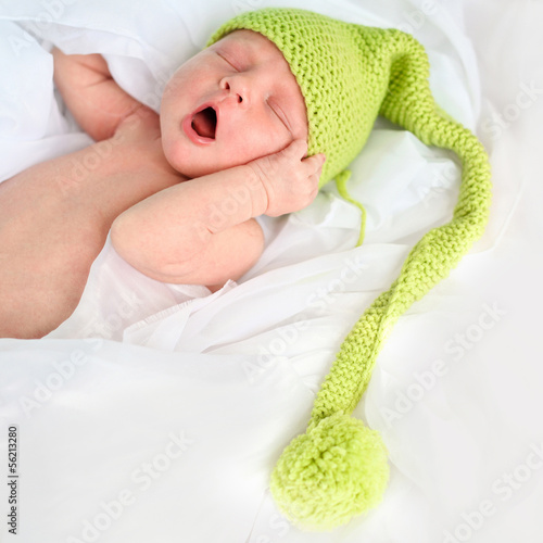 newborn baby in blue hat