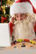Santa Claus with real beard using laptop