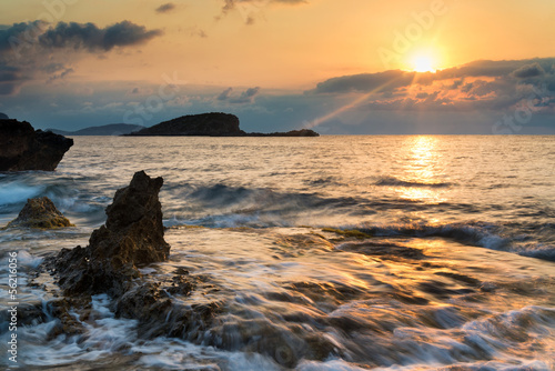 Stunning landscape dawn sunrise with rocky coastline and long ex © veneratio