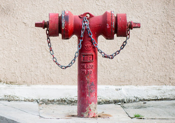 Old red metallic fire hydrant on street