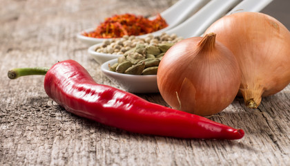 Close up photo of spices with chili pepper and onion