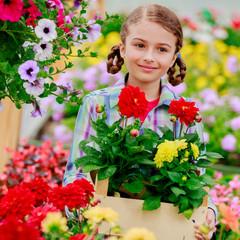 Planting, girl holding flowers in garden center