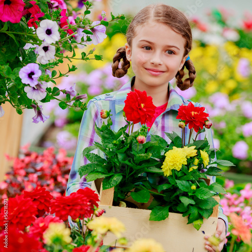 Planting, girl holding flowers in garden center