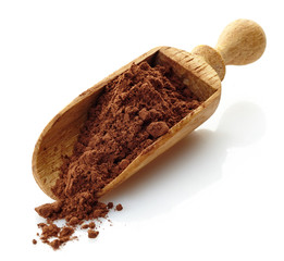 wooden scoop with cocoa powder