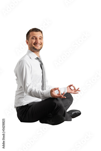 smiley businessman practicing yoga