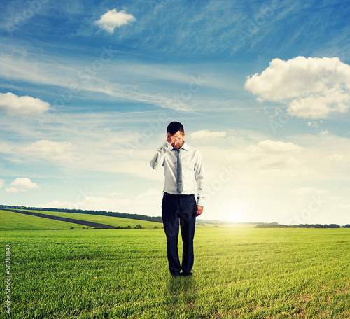 unsuccessful man standing on the field