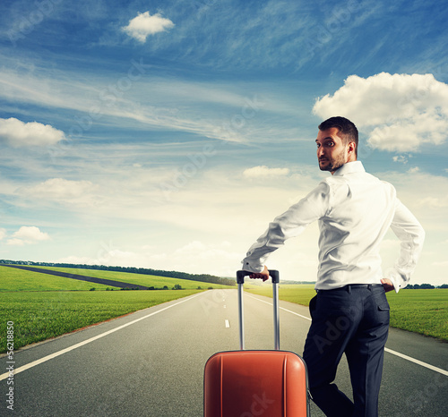 view of man with suitcase and nature
