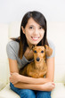 Asian woman and dachshund dog
