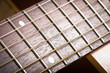 abstract guitar music - rosewood fret board