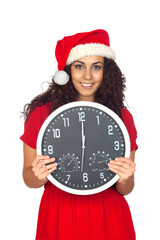Girl in christmas with a clock with twelve o'clock