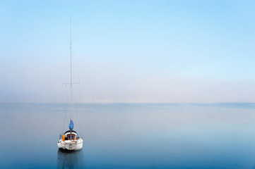 yacht reflected in calm water
