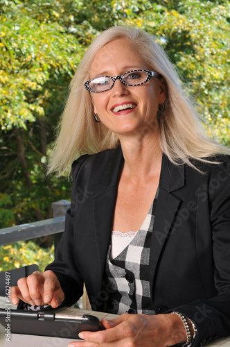 Happy businesswoman working outdoors